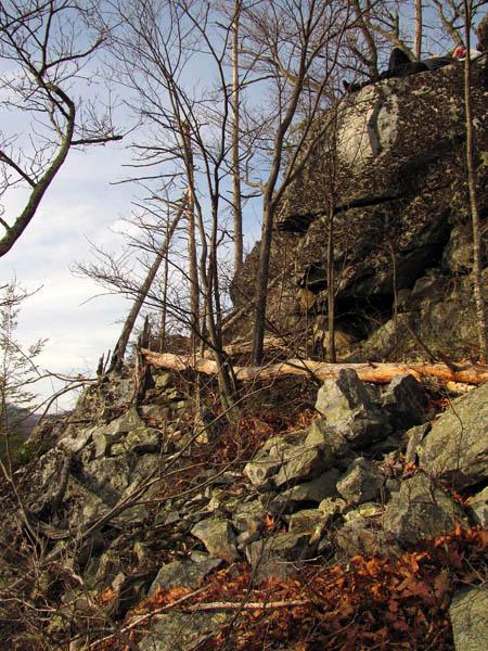 Dano atop rock ledge